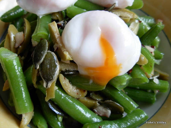 Green bean and hazelnut salad with poached quails eggs