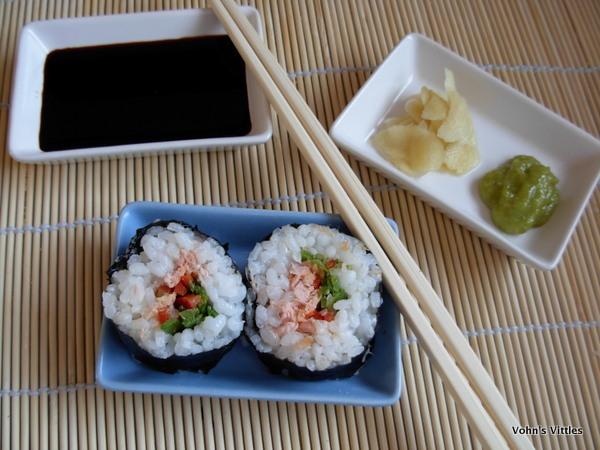 Salmon sushi with accompaniments