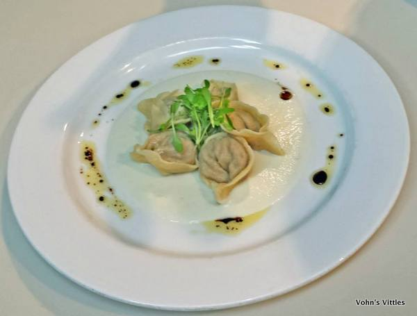 Venison mousse tortellini on cauliflower cream, topped with coriander micro herbs